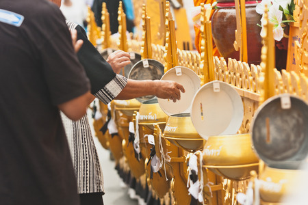 make belief: Make merit and give food offerings to Buddhist monks or Donate money on The End of Buddhist Lent Day in Chak Phra Festival (Pulling the Buddha ) from Surat Thani ( Thailand )
