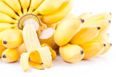 banana skin: half peeled egg banana and  two hand of Golden bananas  on white background healthy Pisang Mas Banana fruit food isolated Stock Photo