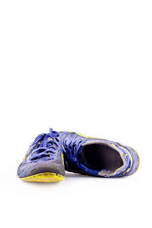 old  football shoes damaged on white background futsal sportware object isolated 版權商用圖片