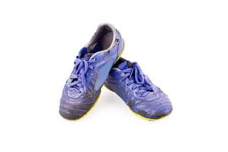 old  football shoes damaged on white background futsal sportware object isolated Reklamní fotografie