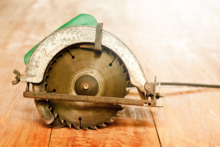 circular saw or power saw on wooden background tool woodcraft object isolated