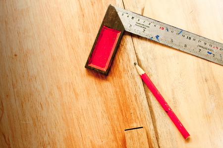 Try Square and wood pencil for carpenter on wooden background tool woodcraft object isolated Banque d'images