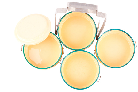 yellow enamelled food carrier ( top view) on white background kitchenware object isolated