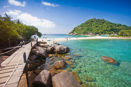 wood bridge on brown rock and beautiful sand beach and clear sea water at nang yuan in koh tao thailand on beautiful nature  landscape background