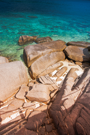 turquoise sea water and brown rock in koh tao thailand on beautiful nature landscape background
