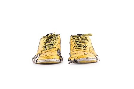 Old damaged synthetic futsal shoes on white background indoor soccer object isolated Stock fotó