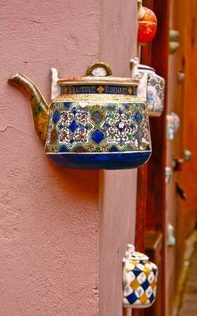 attention grabbing: Old ceramic kettle masoned into the wall Stock Photo
