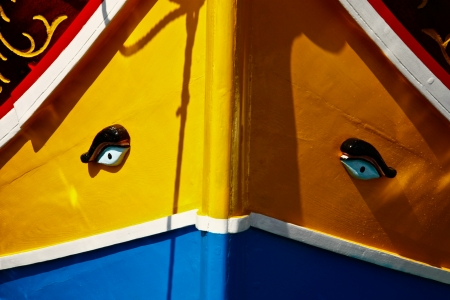 small boat: Colorful Maltese fishing boat with eyes on the prow Stock Photo