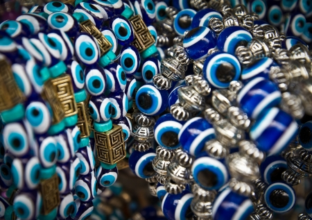 Blue and white porcelain beads souvenirs with metal parts in tourist shop