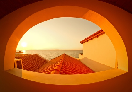 Sunset view through the arched window orange wall Crete photo