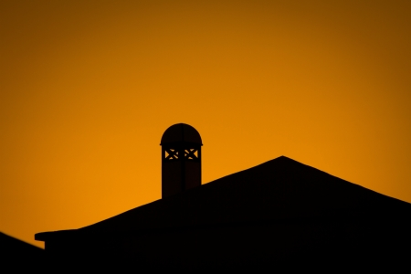 Sunset with silhouette of traditional buinding on Lanzarote island Stock Photo