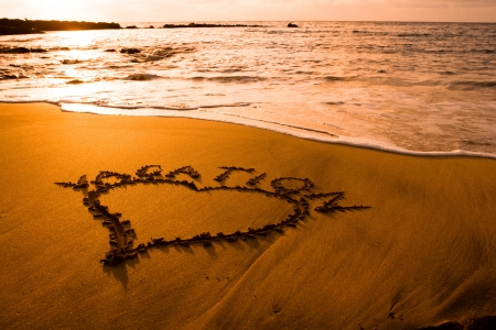 Sunset at a beach with heart sign photo
