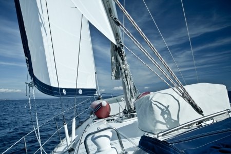 yellow boats: Sailing yacht on a cruise deck view Stock Photo