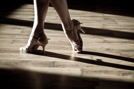 salsa dancing: Female feet on the dance floor