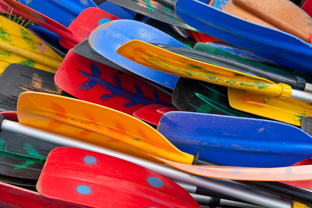 Bunch of plastic colorful oars Imagens