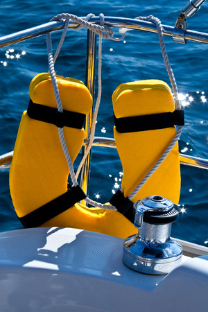 Life buoy and capstan on Sailing yacht Stock Photo