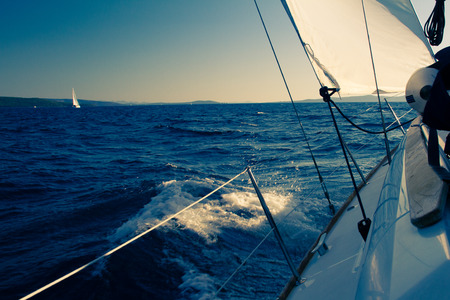 Sailing yacht on a cruise deck view Stock Photo