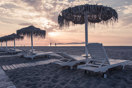 Hotel resort beach sea view with sunshades at sunset chillout color split toning Imagens