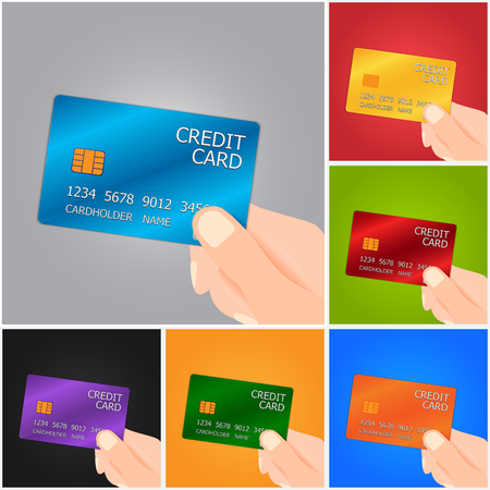 Hand Holding Credit Card on Color Background.