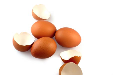 eggshell: Eggs and eggshell on white background Stock Photo