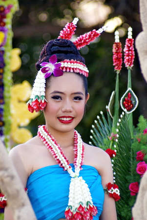 december 25: Chiang rai, Thailand - December 25, 2010: 7th Anniversary Chiang Rai Flower Festival, Unidentified women in parade annual Chiang Rai flower festival. on Dec.25, 2010 in Chiang Rai,Thailand