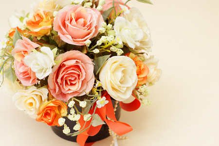 comely: Beautyful artificial flowers with copyspace in composition. Stock Photo