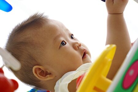 asian infant: Cute Asian infant baby playing in baby walker Stock Photo