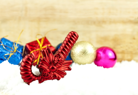 gumballs: Red Candy and Christmas decoration on white snow and wooden texture background Stock Photo