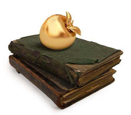 Two old books on white background with a golden apple photo