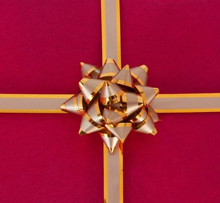 Rad gift with the golden ribbon. Stock Photo - 9737270