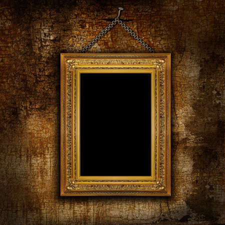 Frame of the painting hanging on a chain on a cracked wall photo