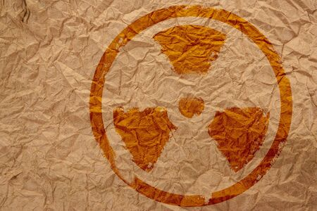 nuclear symbol on crumpled paper Stock Photo - 9818957
