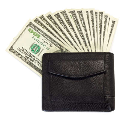 black purse with dollars. isolated on white photo