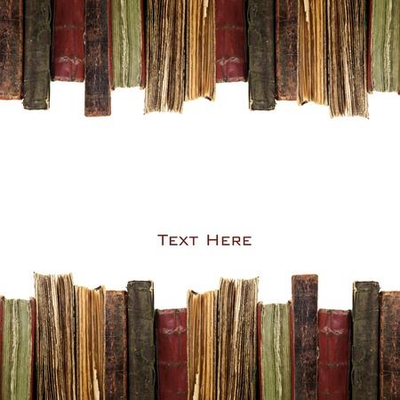 libros antiguos: libros antiguos en una fila aisladas sobre fondo blanco Foto de archivo