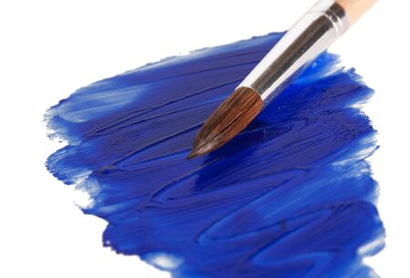 slick blue paint with a brush. isolated on a white background photo