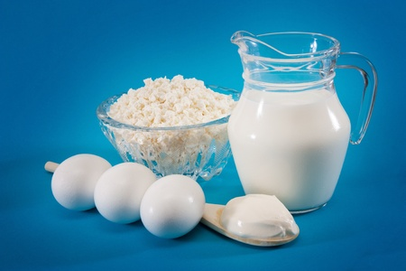 composition of dairy products on a blue background photo
