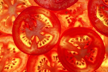 segment: bright red background of the pieces of tomato Stock Photo