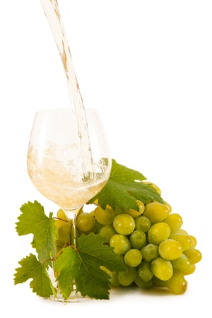 wines: white grapes with a glass of white wine isolated on white background