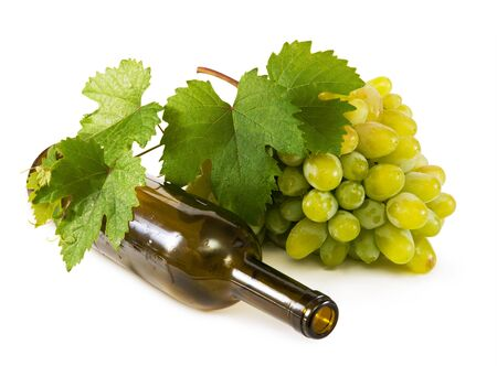 White grapes from the wine bottle isolated on a white background photo