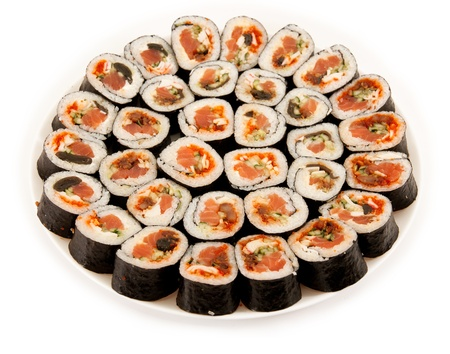 Japanese food. Rolls on a plate isolated on a white background Stock Photo - 10696510