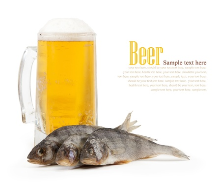 glass of light beer with the fish.isolated on a white background photo