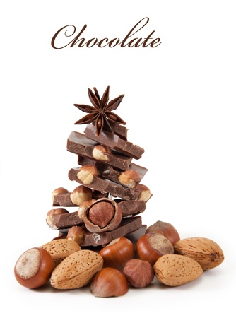 hazelnut tree: Chocolate with nuts is isolated on a white background Stock Photo