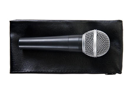 microphone on a leather pouch isolated on white background photo