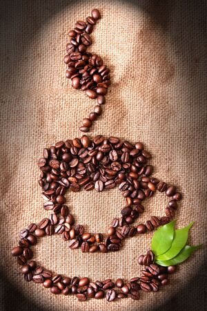 cup of coffee from coffee beans laid out Stock Photo - 10993459
