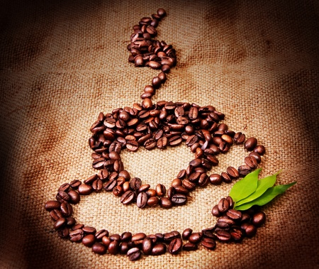 cup of coffee from coffee beans laid out Stock Photo - 11396855