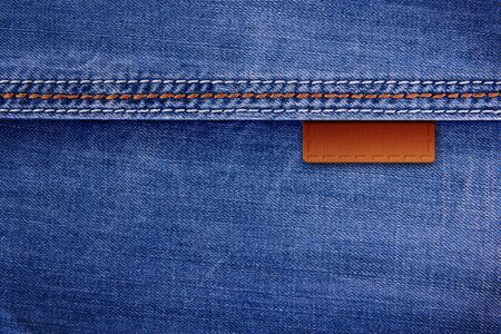 Jeans background with leather inserts Stock Photo - 11396899
