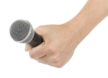 Microphone in hand isolated on white background Stock Photo