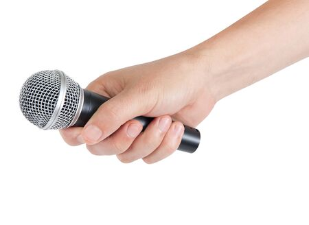 Microphone in hand isolated on white background photo
