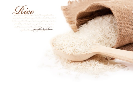 Rice in a bag with a wooden spoon photo