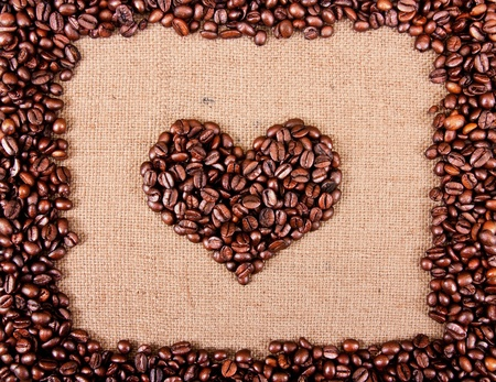 heart from coffee beans on sacking photo